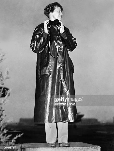 The Aviatrix Amelia Earhart With Raincoat And Binoculars In 1937