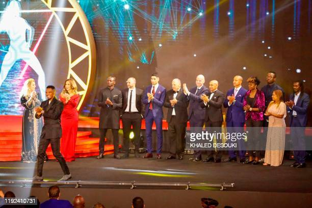 The award winner and presenters pose for a group picture during the 2019 CAF Awards in the Egyptian resort town of Hurghada on January 7 2020