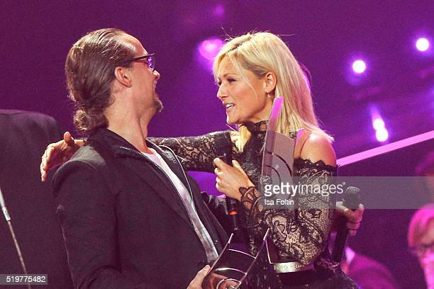 The award winners Alex Christensen and Helene Fischer embrace each other during the Echo Award 2016 show on April 07 2016 in Berlin Germany