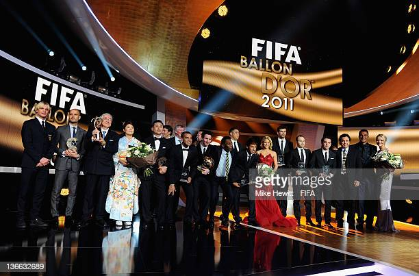 The award winners gather on stage for a group photo during the FIFA Ballon d'Or Gala 2011 at the Kongresshaus on January 09 2012 in Zurich Switzerland