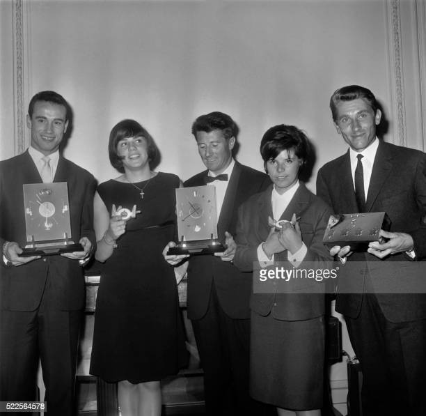 The awardwinners of the Prize of Sport Academy 1964 pose with their prize on May 05 1964 at the Automobile Club headquarters in Paris JeanClaude...