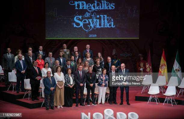 The award-winnings pose during the act of delivery of the titles of Favorite Son and Medals of the City, in the Lope de Vega theatre on May 30, 2019...