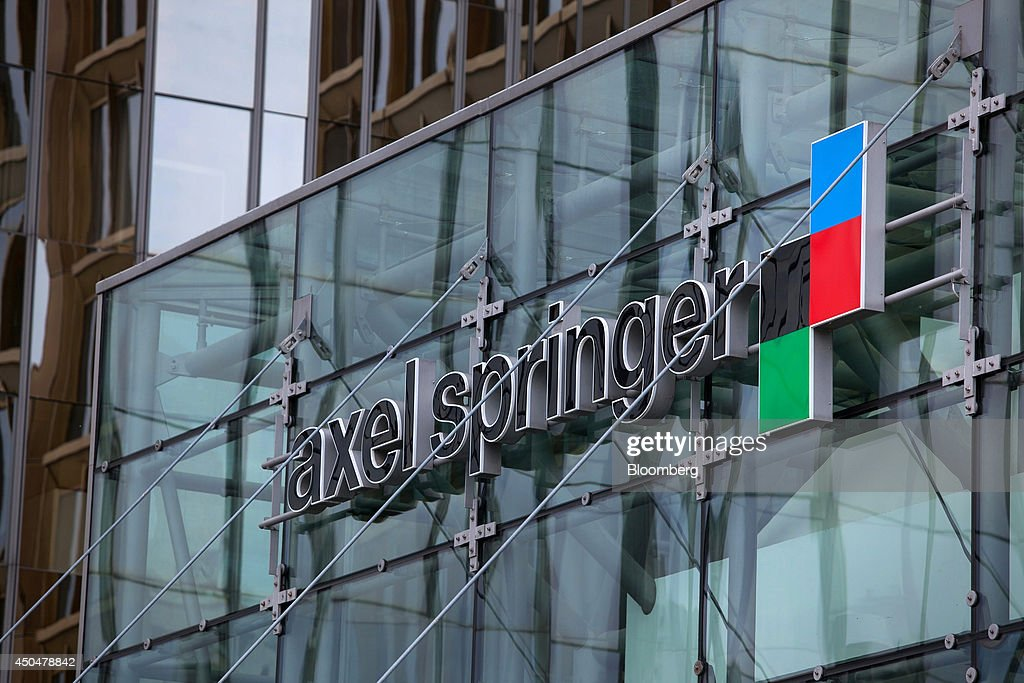 The Axel Springer SE logo sits on the exterior of the newspaper publisher's offices in Berlin, Germany, on Wednesday, June 11, 2014. Axel Springer, Europe's biggest newspaper publisher, is working with JPMorgan Chase & Co. and Citigroup Inc. on an initial public offering of its digital-classifieds business, people familiar with the matter said. Photographer: Krisztian Bocsi/Bloomberg via Getty Images