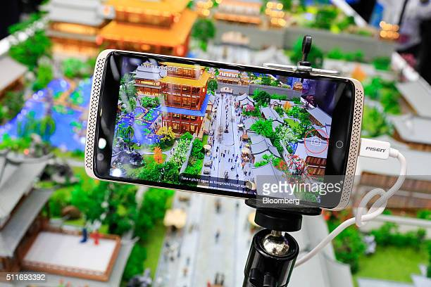 The Axon mobile phone manufactured by ZTE Corp stands on display at the Mobile World Congress in Barcelona Spain on Monday Feb 22 2016 Mobile World...