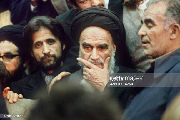 The Ayatollah Ruhollah Khomeini is surrounded by his supporters in Tehran 01 February 1979 the day of his return from France after 15 years of exile...