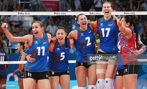 The Azerbaijan team celebrate after winning the Women's Volleyball Group A match between Italy during day five of the Baku 2015 European Games at the...