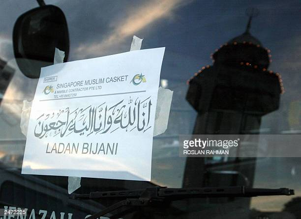 The Ba'Alwi Mosque minaret reflects on a windscreen of the hearse van of Ladan Bijani in Singapore 09 July 2003 The bodies of Ladan and Laleh Bijani...