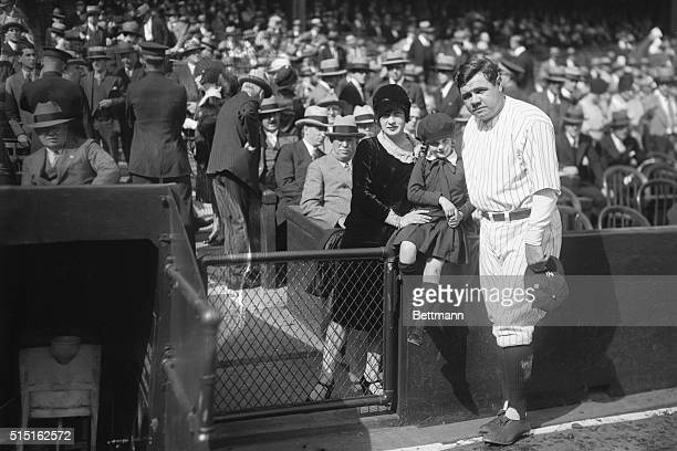 """The Babe and His Family. Bronx, New York: George Herman """"Babe"""" Ruth with his wife and baby daughter, Dorothy, snapped before the third game of the..."""