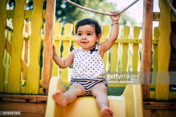 the baby is playing outside - baby girls stock pictures, royalty-free photos & images