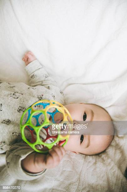 The baby is playing with toy