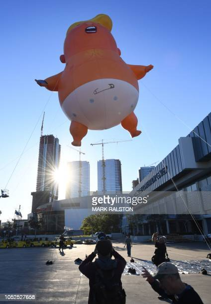 The Baby Trump balloon flies over the Convention Center as it makes first West Coast appearance during the lead up to the weekends 4th annual...