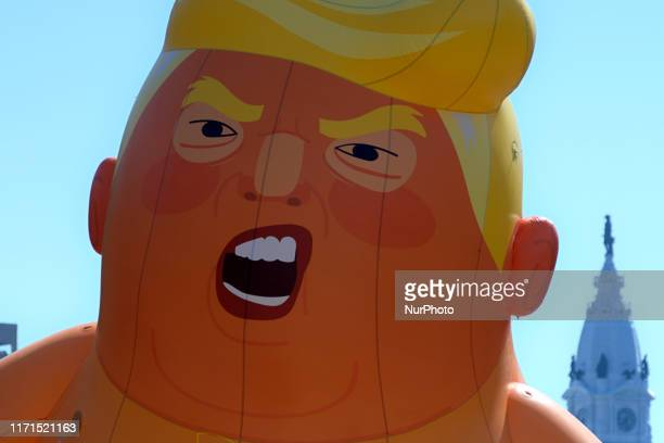 The Baby Trump balloon participates in Peoples March for Puerto Rico commemorating the second anniversary of Hurricane Marina at a protest march in...