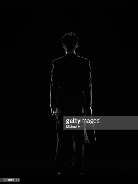 The back figure of the businessman