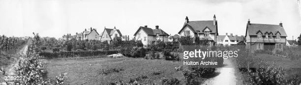 The back gardens of houses in Letchworth Garden City in Hertfordshire