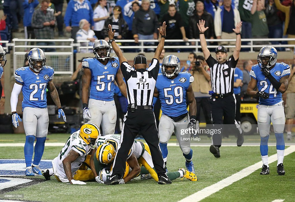The back judge Terrence Miles #111 signals the touchdown good after Richard Rodgers #82 of the Green Bay Packers catches a 61 yard pass to win the game 27-23 over the Detroit Lions on December 3 2015 at Ford Field in Detroit, Michigan.