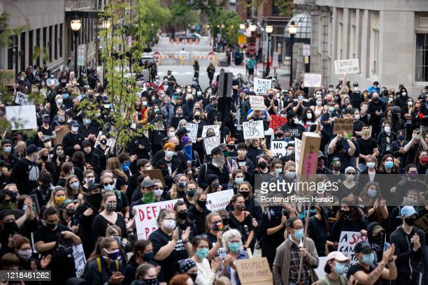 The back of a crowd of over 1000 people spills down Exchange Street at a protest against police brutality and in solidarity with black lives outside...