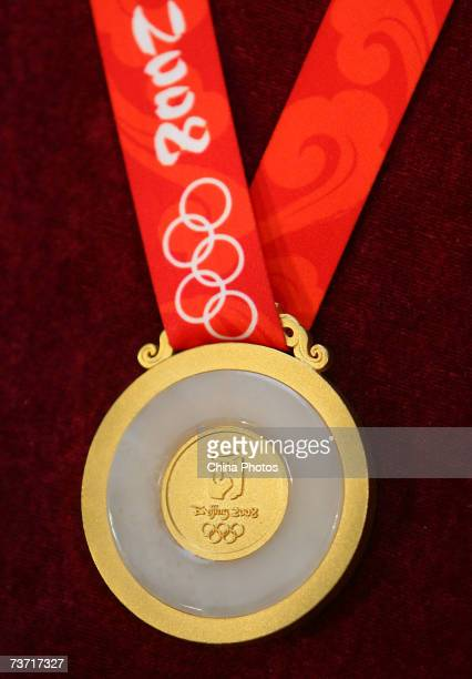 The back of a gold medal for the Beijing 2008 Olympic Games is displayed during a ceremony hosted by the Beijing Organising Committee for the Games...