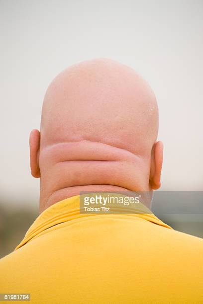 the back of a man?s shaved head - completely bald stock pictures, royalty-free photos & images