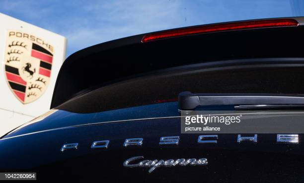 The back of a Porsche Cayenne can be seen on near the logo of the company in Stuttgart Germany 4 November 2015 After VW exhaust affair Porsche...