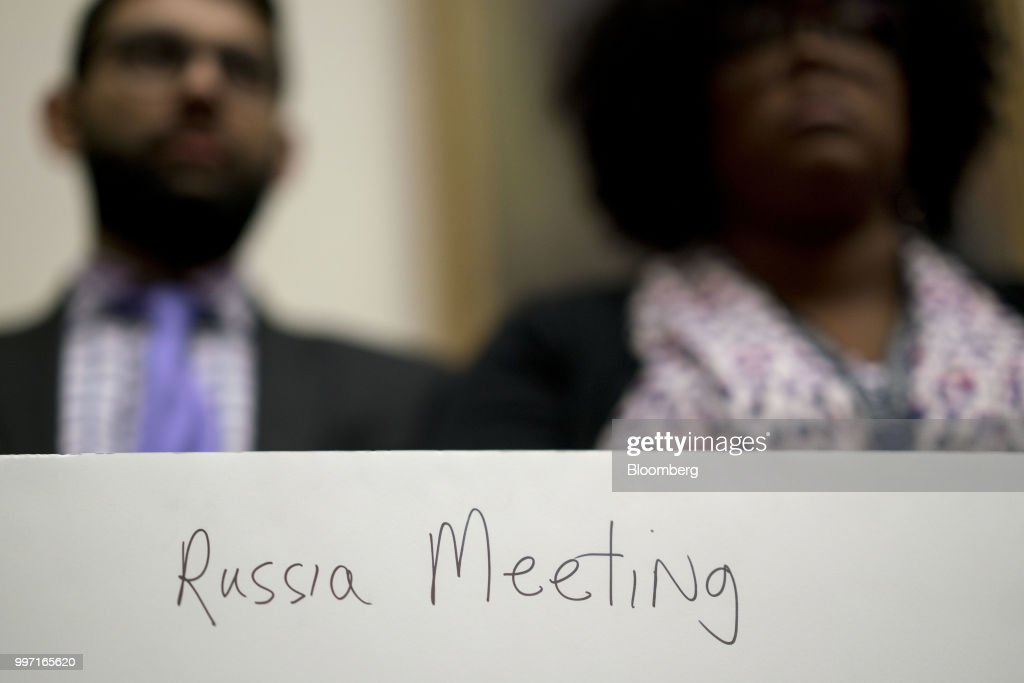The back of a poster, held by a staff member, reads 'Russia Meeting' during a joint House Judiciary, Oversight and Government Reform Committees hearing with Federal Bureau of Investigation (FBI) agent Peter Strzok, not pictured, in Washington, D.C., U.S., on Thursday, July 12, 2018. Strzok, the FBI agent who exchanged anti-Trump texts with a bureau lawyer, denied he did anything improper, as he faced a hearing called by Republican lawmakers who say he personifies bias that tainted the agency's Russia investigation early on. Photographer: Andrew Harrer/Bloomberg via Getty Images