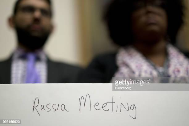 The back of a poster held by a staff member reads 'Russia Meeting' during a joint House Judiciary Oversight and Government Reform Committees hearing...