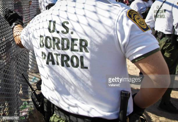 the back of a united states border patrol agent - geographical border stock pictures, royalty-free photos & images