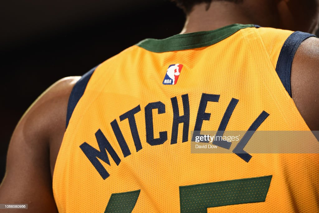 4cbf71f7fd2a the back of Donovan Mitchell of the Utah Jazz jersey is seen against ...