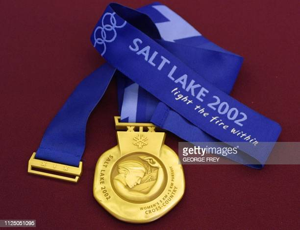 The back of the gold medal for the Salt Lake City 2002 Winter Olympics is displayed at an unveiling ceremony 15 October 2001 in Salt Lake City Utah...
