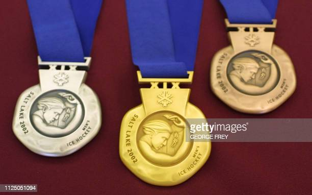 The back of the medals for the Salt Lake City 2002 Winter Olympics are displayed at an unveiling ceremony 15 October 2001 in Salt Lake City Utah The...