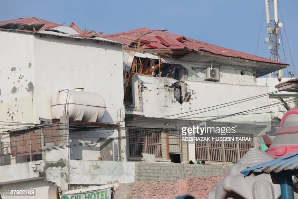 The back of the SYL hotel's walls are ridden with bullet holes in Mogadishu on December 11, 2019. - An attack by members of the radical Islamic group...