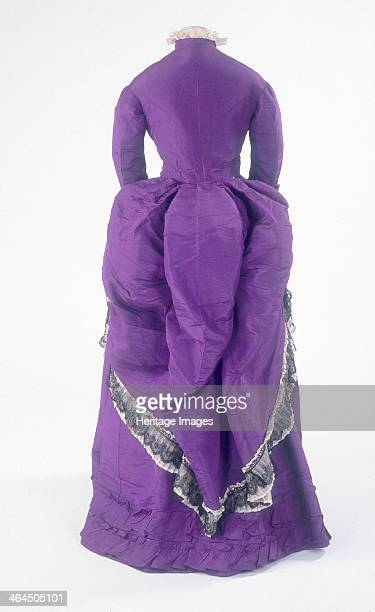 The back view of a fashionable day dress c1875 The skirt drapery is predominantly at the back of the dress where it was supported by a bustle a false...