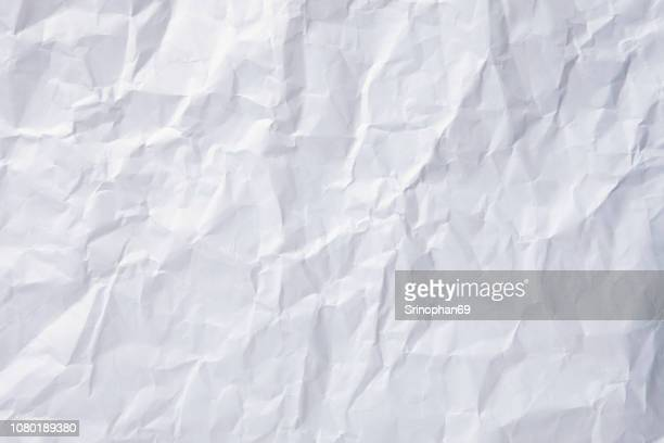 the background is white. texture of paper with kinks and dents, old and dilapidated. white crumpled paper texture background. - wrinkled stock pictures, royalty-free photos & images