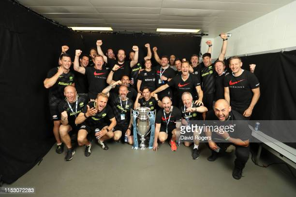 The backroom staff that helped Saracens win the trophy pose for a photo following the Gallagher Premiership Rugby Final between Exeter Chiefs and...