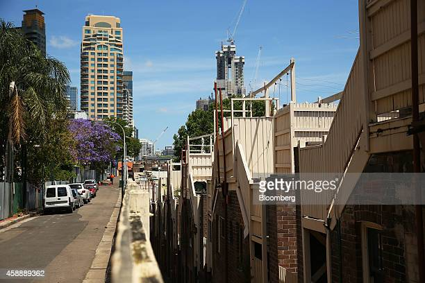 The backs of a row of houses are seen in the Millers Point district as Lend Lease Group's Barangaroo South redevelopment rear right stands under...