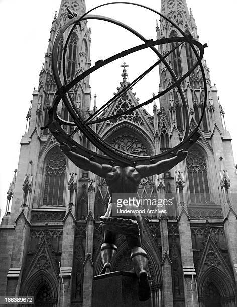 The backside of the statue of Atlas at the International Building in Rockefeller Center facing St. Patrick's Cathedral in Manhattan, New York, New...