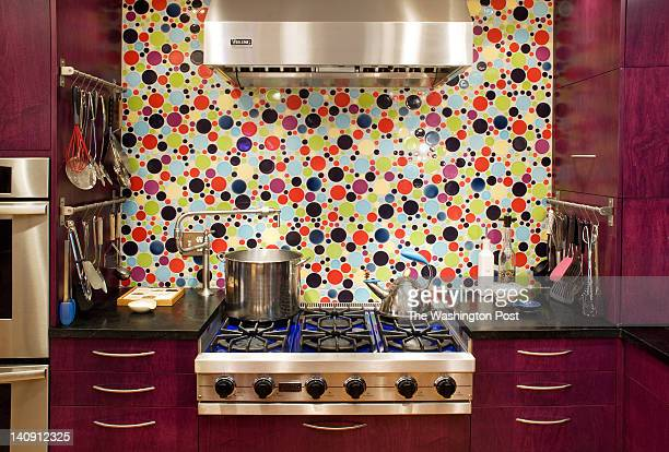 The backsplash is a showstopping focal point made up of circleshaped tiles homeowner Paula Jacobson found for her kitchen remodel at Architectural...