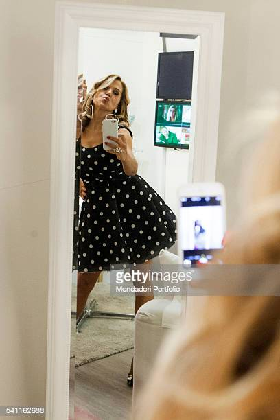 Italian TV presenter Barbara D'Urso photographing herself in the mirror in the dressing room Photo shooting Cologno Monzese 19th October 2015