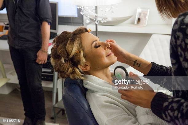 Italian TV presenter Barbara D'Urso adjusting her make up and her hair in the dressing room Photo shooting Cologno Monzese 19th October 2015