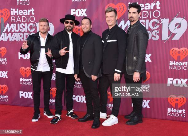 The Backstreet Boys members Brian Littrell AJ McLean Howie Dorough Nick Carter and Kevin Richardson arrive for the 2019 iHeart Radio Music Awards at...