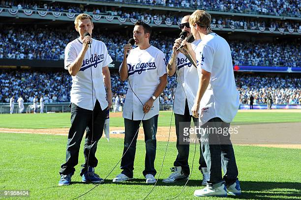 The Backstreet Boys perform God Bless America in the seventh inning stretch during Game Two of the NLCS during the 2009 MLB Playoffs between the Los...