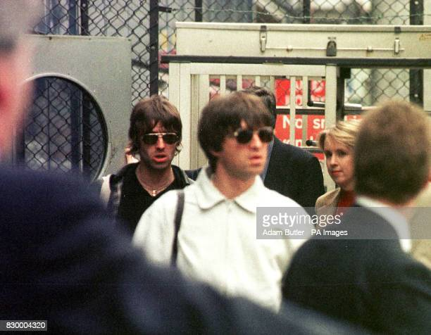 The bad boys of rock brothers Noel and Liam Gallagher of the band Oasis arrive back at Gatwick Airport today from Mexico at the end of their...