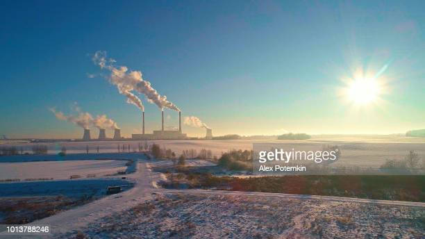 The bad ecology. The thermal power plant near by big city in the cold winter's day. Aerial drone photo