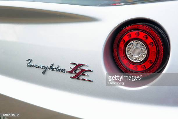 The badge of a GLM Co Tommykaira ZZ electric vehicle is displayed on the rear of the automobile at the company's RD facility in Uji Kyoto Prefecture...