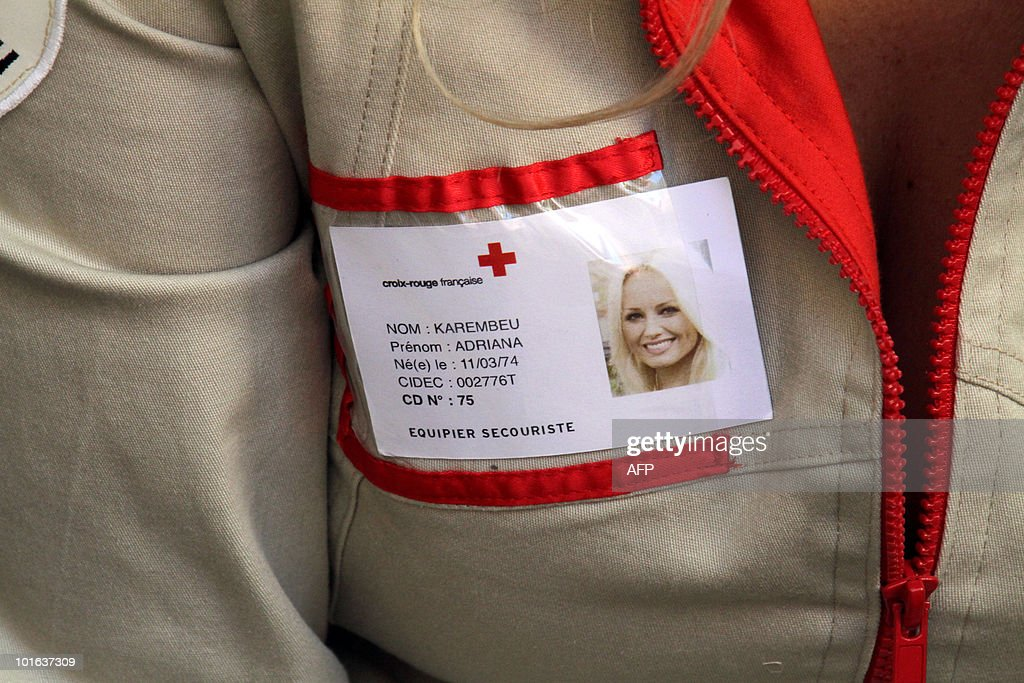 The badge of Slovakian born French goodwill ambassador and top-model Adriana Karembeu is seen on her jacket during the launch of the Red Cross 2010 national fundraising campaign by French Red Cross (Croix Rouge française) on June 5, 2010 in Nimes, southern France.
