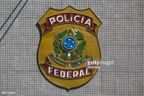 The badge of the Federal Police is displayed outside their headquarters in Brasilia, Brazil, on Tuesday, May 23, 2017. Brazil's unpopular President,...