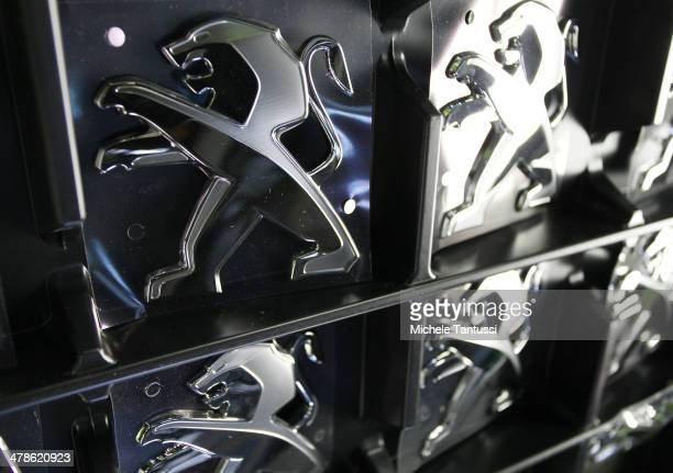 The badges of a Peugeot 2008 SUVs sit ready for assembly at the PSA Peugeot Citroen assembly plant on March 14 2014 in Mulhouse France Chinese...