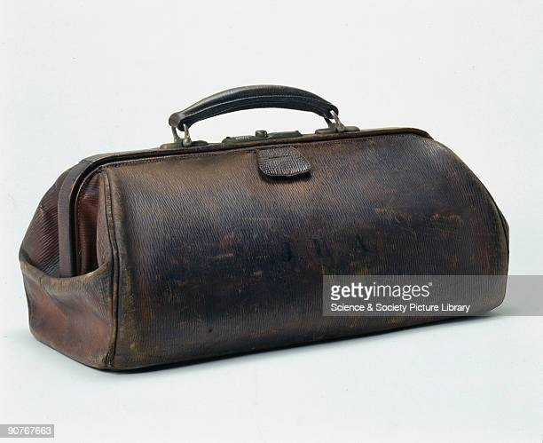 The bag originally belonged to Professor John Hill Abram It contains a variety of medical instruments including stethoscopes and syringes Made of...