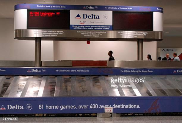The baggage carousel at Atlanta HartsfieldJackson International Airport lies quiet for Comair Flight 1066 from Lexington Kentucky the flight that was...
