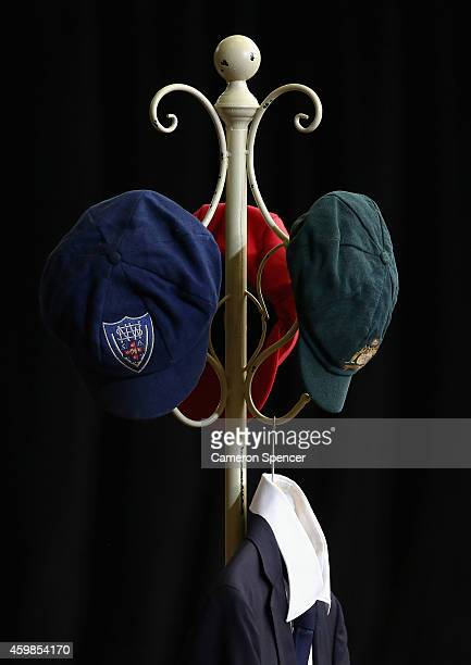 The baggy green of Phillip Hughes and his state cricket caps are seen on a hat rack inside the Macksville High School Stadium ahead of the Funeral...