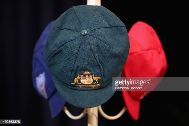 The Baggy Green of Phillip Hughes and his state cricket caps are seen on a hat rack inside the Macksville High School Stadium during the Funeral...